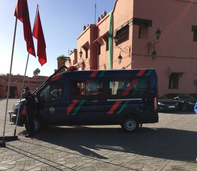 surrete-national-on-square-and-interior-ministry-limousines-in-back.jpg